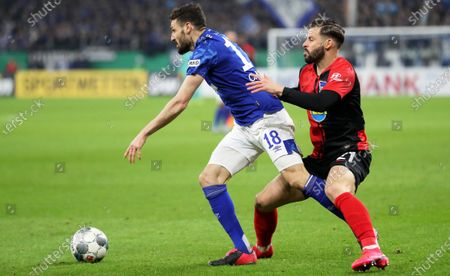 Schalke's Daniel Caligiuri (L) in action against Hertha's Marvin Plattenhardt (R) during the German DFB Cup round of 16 soccer match between Schalke 04 and Hertha BSC Berlin in Gelsenkirchen, Germany, 04 February 2020 (issued on 05 February 2020).