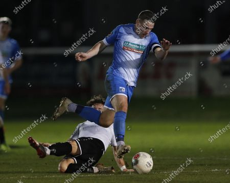 John Rooney of Barrow escapes from the tackle of Jack Munns during Dover Athletic vs Barrow, Vanarama National League Football at the Crabble Athletic Ground on 4th February 2020
