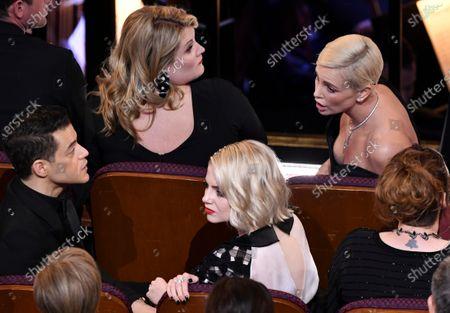 Rami Malek, Lucy Boynton and Charlize Theron