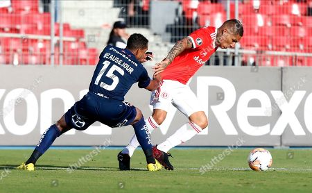 Guerrero, Jean Beausejour. Jean Beausejour of Universidad de Chile, left, fights for control of the ball with Guerrero of Brazil's SC Internacional during a Copa Libertadores soccer game in Santiago, Chile