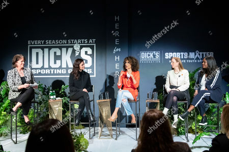 Stock Picture of Christine Brennan (left) moderates panel with Katie Holmes, Elaine Welteroth, Cathy Engelbert and Benita Fitzgerald-Mosley in New York City on