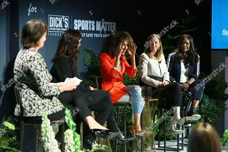 Elaine Welteroth, center, speaks on DICK'S Sporting Goods panel for 'Here for Her' Summit alongside, left to right, Christine Brennan, Katie Holmes, Cathy Engelbert and Benita Fitzgerald-Mosley on in New York