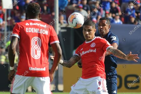 U. de Chile's Jean Beausejour (R) vies for the ball with Paolo Guerrero (2R) of Internacional during the Copa Libertadores second round first leg match between Universidad de Chile and International of Brazil, at the Nacional Stadium in Santiago, Chile, 04 February 2020.