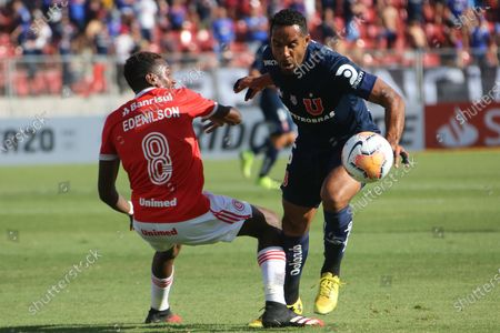 U. de Chile's Jean Beausejour (R) vies for the ball with Edenilson (L) of Internacional during the Copa Libertadores second round first leg match between Universidad de Chile and Internacional of Brazil, at the Nacional Stadium in Santiago, Chile, 04 February 2020.