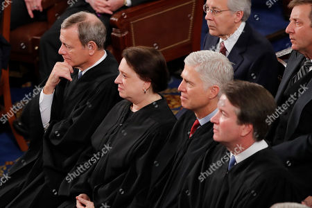 Chief Justice of the United States John Roberts, from left, Supreme Court Associate Justice Elena Kagan, Supreme Court Associate Justice Neil Gorsuch, and Supreme Court Associate Justice Brett Kavanaugh listen President Donald Trump delivers his State of the Union address to a joint session of Congress on Capitol Hill in Washington