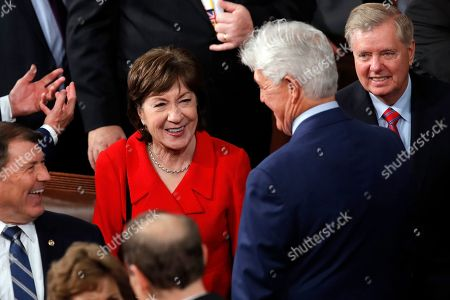Sen. Susan Collins, R-Maine, arrives before President Donald Trump delivers his State of the Union address to a joint session of Congress on Capitol Hill in Washington, . At far right is Sen. Lindsey Graham, R-S.C