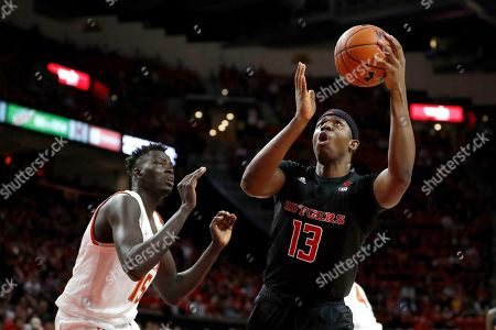 Rutgers forward Shaq Carter (13) goes up for a shot next to Maryland center Chol Marial (15) during the first half of an NCAA college basketball game, in College Park, Md