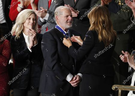 US First Lady Melania Trump places the Presidential Medal of Freedom on Rush Limbaugh (C) as US President Donald J. Trump announces the awarding of the medal as he delivers his State of the Union address during a joint session of congress in the House chamber of the US Capitol in Washington, DC, USA 04 February 2020. President Trump delivers his address as his impeachment trial is coming to an end with a final vote on the 2 articles of impeachment scheduled for 05 February.
