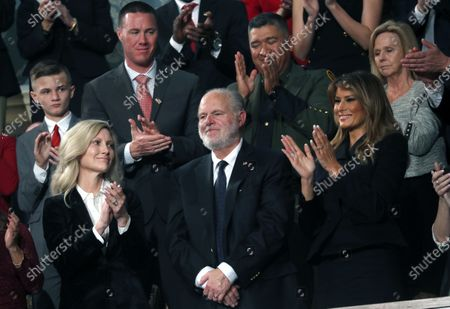 Radio personality Rush Limbaugh (C) is honored by US President Donald Trump with a Presidential Medal of Freedom as he stands with first lady Melania Trump (R, front) during the State of the Union address to a joint session of the US Congress in the House chamber of the US Capitol in Washington, DC, USA, 04 February 2020.