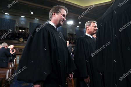 US Supreme Court Associate Justice Brett Kavanaugh (C) and Chief Justice John Roberts (R) arrive for US President Donald Trump's State of the Union address to a joint session of the US Congress in the House chamber of the US Capitol in Washington, DC, USA, 04 February 2020.
