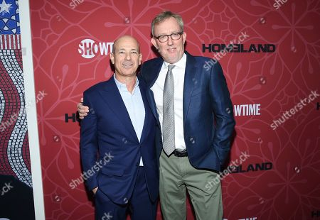 """Stock Photo of Howard Gordon, Alex Gansa. Co-creator and executive producers Howard Gordon, left, and Alex Gansa pose together at Showtime's """"Homeland"""" eighth and final season premiere at the Museum of Modern Art, in New York"""