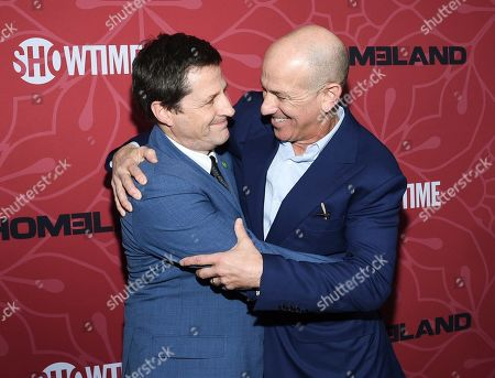 """Stock Photo of Tim Guinee, Howard Gordon. Actor Tim Guinee, left, and executive producer attend Showtime's """"Homeland"""" eighth and final season premiere at the Museum of Modern Art, in New York"""
