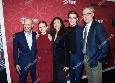 """Howard Gordon, Morgan Saylor, Morena Baccarin, Jackson Pace, Alex Gansa. Co-creator and executive producer Howard Gordon, left, actress Morgan Saylor, actress Morena Baccarin, actor Jackson Pace and co-creator and executive producer Alex Gansa pose together at Showtime's """"Homeland"""" eighth and final season premiere at the Museum of Modern Art, in New York"""