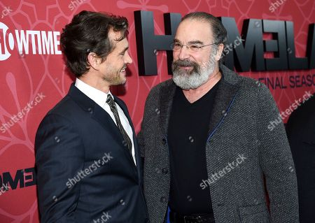 """Hugh Dancy, Mandy Patinkin. Actors Hugh Dancy, left, and Mandy Patinkin attend Showtime's """"Homeland"""" eighth and final season premiere at the Museum of Modern Art, in New York"""