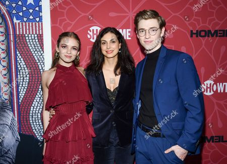 """Morgan Saylor, Morena Baccarin, Jackson Pace. Actors Morgan Saylor, left, Morena Baccarin and Jackson Pace attend Showtime's """"Homeland"""" eighth and final season premiere at the Museum of Modern Art, in New York"""
