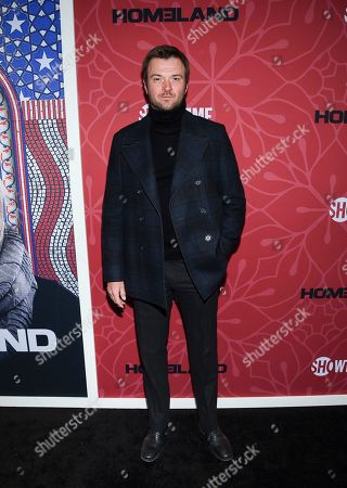 """Stock Photo of Costa Ronin attends Showtime's """"Homeland"""" eighth and final season premiere at the Museum of Modern Art, in New York"""