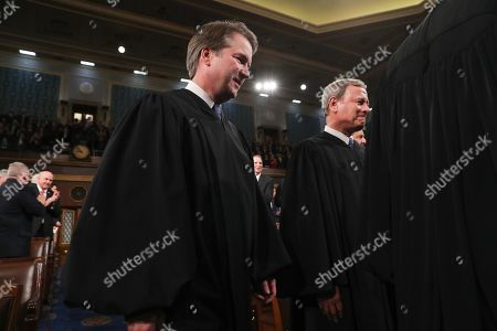 U.S. Supreme Court Associate Justice Brett Kavanaugh and Chief Justice John Roberts arrive for U.S. President Donald Trump's State of the Union address to a joint session of the U.S. Congress in the House Chamber of the U.S. Capitol