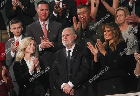 Radio personality Rush Limbaugh is honored by U.S. President Trump with a Presidential Medal of Freedom as he stands with first lady Melania Trump during the State of the Union address to a joint session of the U.S. Congress in the House Chamber of the U.S. Capitol