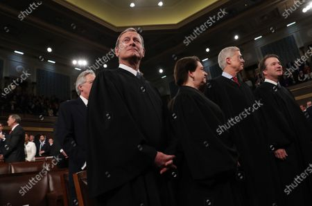 Chief Justice of the United States John Roberts, Associate Justice Elena Kagan, Associate Justice Neil Gorsuch and Associate Justice Brett Kavanaugh look on before the start of U.S. President Donald Trump's State of the Union address to a joint session of the U.S. Congress in the House Chamber of the U.S. Capitol