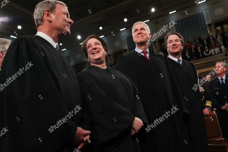 Chief Justice of the United States John Roberts, Associate Justice Elena Kagan, Associate Justice Neil Gorsuch and Associate Justice Brett Kavanaugh talk before the start of U.S. President Donald Trump's State of the Union address to a joint session of the U.S. Congress in the House Chamber of the U.S. Capitol