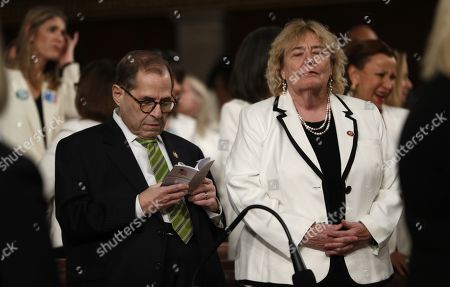 House impeachment manager and Judiciary Committee Chairman Jerry Nadler (D-NY) reads a pocket copy of the U.S. Constitution as fellow manager Rep. Zoe Lofgren (D-CA) stands with her eyes closed beside him as they wait for the start of U.S. President Donald Trump's State of the Union address to a joint session of the U.S. Congress in the House Chamber of the U.S. Capitol