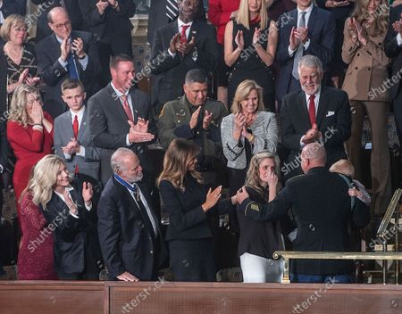 A military spouse was reunited with her Army sergeant husband during President Trump's State of the Union address. As he addressed Congress, Trump surprised Amy Williams by bringing out her husband, Sgt. First Class Townsend Williams, who had been deployed in Afghanistan.
