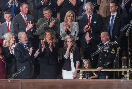 Stock Photo of A military spouse was reunited with her Army sergeant husband during President Trump's State of the Union address. As he addressed Congress, Trump surprised Amy Williams by bringing out her husband, Sgt. First Class Townsend Williams, who had been deployed in Afghanistan.