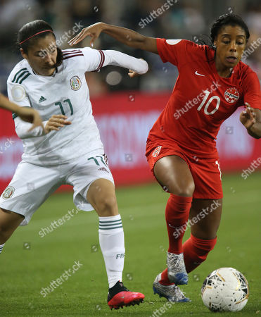 Mexico's Jacqueline Ovalle (11) and Canada's Ashley Lawrence (10) go for the ball during a CONCACAF women's Olympic qualifying soccer match, in Edinburg, Texas
