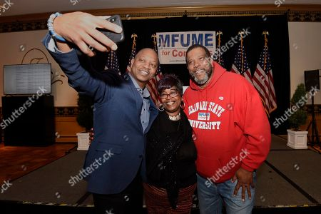Supporters of Kweisi Mfume, Democratic nominee for Maryland's 7th Congressional District, left to right, Scott Phillips, Lynda M. Brown and Aaron Barnett take a selfie at a victory party, in Baltimore