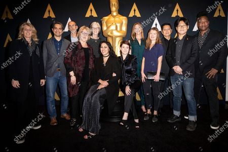 Stock Image of (L-R) Academy Documentary Branch Governo Rory Kennedy, nominees for Documentary (Short Subject) Sami Khan, John Haptas, Academy Documentary Branch Governor Kate Amend, nominees Kristine Samuelson, Smriti Mundhra, Laura Nix, Colette Sandstedt, Elena Andreicheva, Gary Byung-Seok Kam, Yi Seung-Jun and Academy Documentary Branch Governor Roger Ross Williams, pose during the Oscar Week: Documentary event at the Academy of Motion Picture Arts and Sciences in Beverly Hills, California, USA, 04 February 2020.