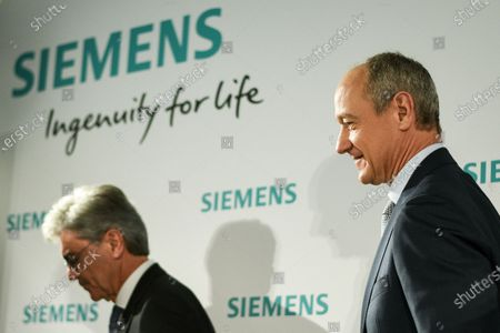 Stock Picture of Siemens CEO Joe Kaeser (L) and Siemens Chief Operating Officer (COO) Roland Busch attend the Siemens AG Annual Shareholders' Meeting in Munich, Germany, 05 February 2020.