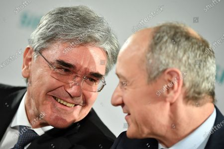 Siemens CEO Joe Kaeser (L) and Siemens Chief Operating Officer (COO) Roland Busch attend the Siemens AG Annual Shareholders' Meeting in Munich, Germany, 05 February 2020.