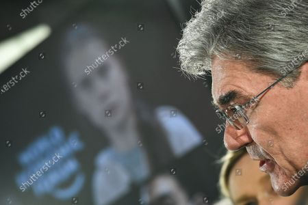 Siemens CEO Joe Kaeser speaks in front of a picture of climate activist Greta Thunberg during the Siemens AG Annual Shareholders' Meeting in Munich, Germany, 05 February 2020.