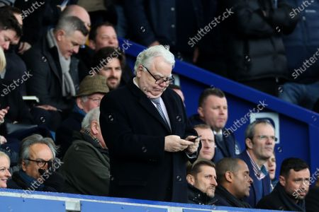 Stock Photo of Bill Kenwright on his phone in the stands