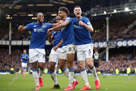 Dominic Calvert-Lewin of Everton celebrates scoring his sides third goal with Djibril Sidibe, Yerry Mina and Michael Keane to make the score 3-1