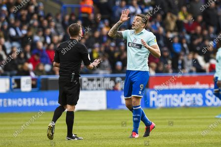 Jordan Hugill of QPR argues with Referee David Webb