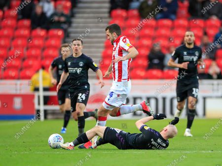 8th February 2020, Bet365 Stadium, Stoke-on-Trent, England; Sky Bet Championship, Stoke City v Charlton Athletic : Tommy Smith (14) of Stoke City is challenged by Jonathan Williams (7) of Charlton Athletic
