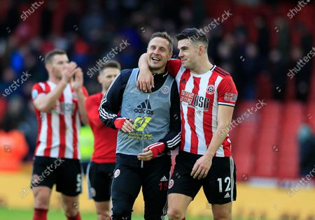 9th February 2020, Bramall Lane, Sheffield, England; Premier League, Sheffield United v Bournemouth : Phil Jagielka (15) of Sheffield United and John Egan (12) celebrate the 2-1 victory