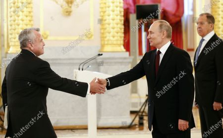 Russian President Vladimir Putin (C) receives credentials from the new U.S. Ambassador to Russia John Sullivan (L) as Russian Foreign Minister Sergei Lavrov (R) looks on during a ceremony to receive credentials from newly appointed foreign ambassadors to Russia in the Kremlin in Moscow, Russia, 05 February 2020.