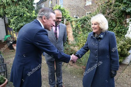 Stock Image of Camilla Duchess of Cornwall meets chair of trustees John Bartlett (left) and chief executive Javed Khan during a visit to Barnardo's Child and Sexual Abuse and Exploitation Services