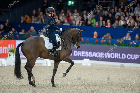 Stock Image of Charlotte Dujardin of Great Britan riding Mount St John Freestyle at Grand Prix Freestyle presented by VriendenLoerij - Jumping Amsterdam on in Amsterdam. (Photo by Thomas Reiner/ESPA-Images)