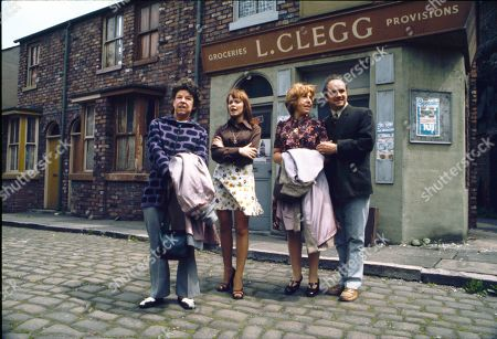 Stock Picture of Promotional shots of the Hopkins family arriving in the Street. Jessie Evans (as Granny Hopkins), Kathy Jones (as Tricia Hopkins), Kathy Staff (as Vera Hopkins) and Richard Davies (as Idris Hopkins)