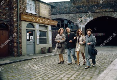 Stock Image of Promotional shots of the Hopkins family arriving in the Street. Kathy Staff (as Vera Hopkins), Richard Davies (as Idris Hopkins), Kathy Jones (as Tricia Hopkins) and Jessie Evans (as Granny Hopkins)