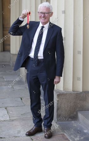Stock Picture of Sir Norman Lamb with his Knighthood after an Investiture at Buckingham Palace