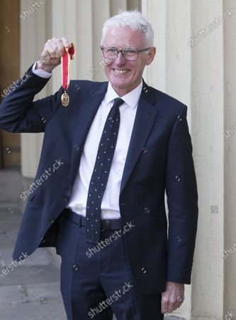 Stock Photo of Sir Norman Lamb with his Knighthood after an Investiture at Buckingham Palace