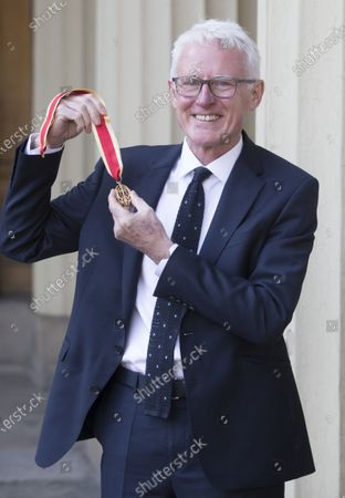 Sir Norman Lamb with his Knighthood after an Investiture at Buckingham Palace