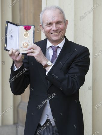 Sir David Lidington with his Knighthood after an Investiture at Buckingham Palace