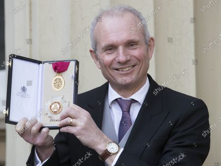 Stock Image of Sir David Lidington with his Knighthood after an Investiture at Buckingham Palace