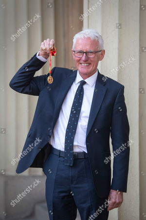 Sir Norman Lamb with his knighthood for public and political service following an investiture ceremony at Buckingham Palace
