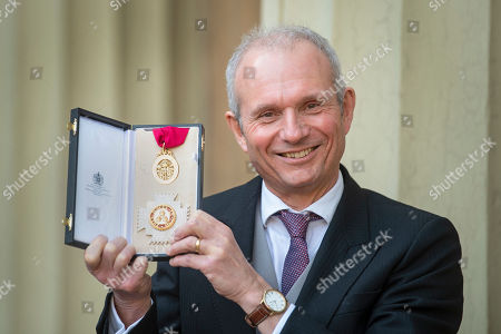 Stock Photo of Sir David Lidington after receiving a knighthood for political and public service at an investiture ceremony at Buckingham Palace